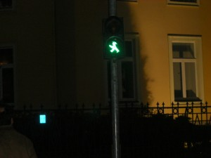 the little green figure - with hat - symbolisizing it is safe to cross