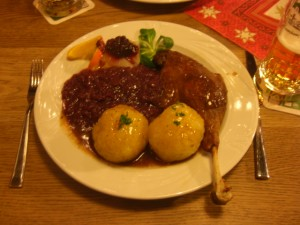 Leg of goose, potato dumplings, with red cabbage